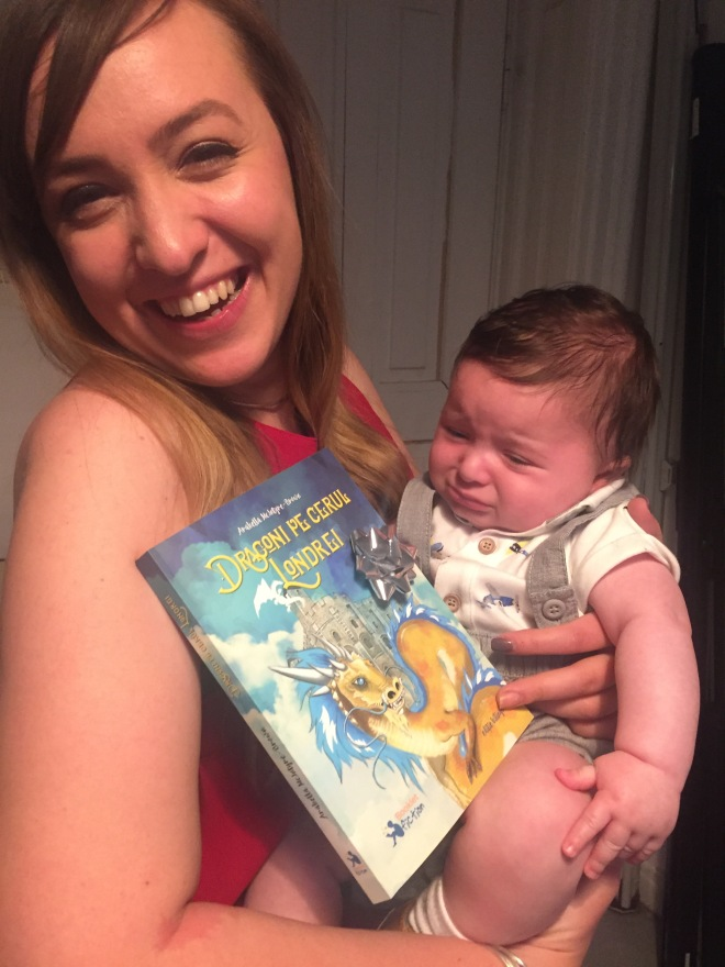 Woman holds baby and book Dragons over London
